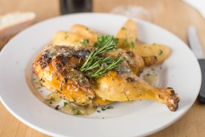 Roasted half chicken, disjointed, sauteed with olive oil, garlic, rosemary, roasted potatoes.