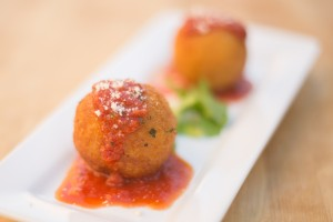 Saffron risotto balls, stuffed with bolognese, peas & scamorza cheese, fried and served with fresh marinara sauce.